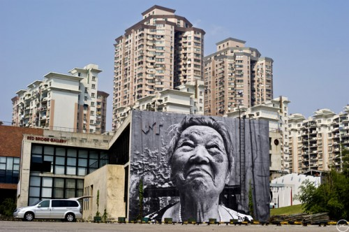 JR ShanghaiHD L1000592 500x332 Amazing Street Art by French Artist JR