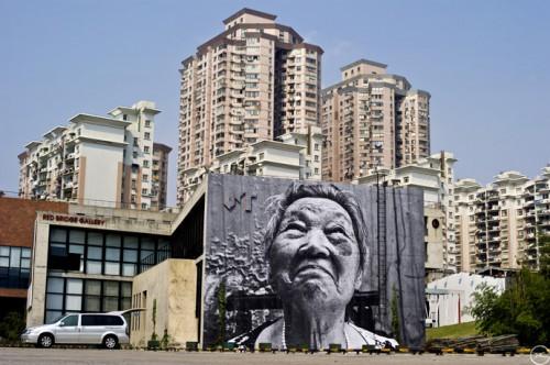 JR ShanghaiHD L1000592 500x332 Amazing Street Art by French Artist JR