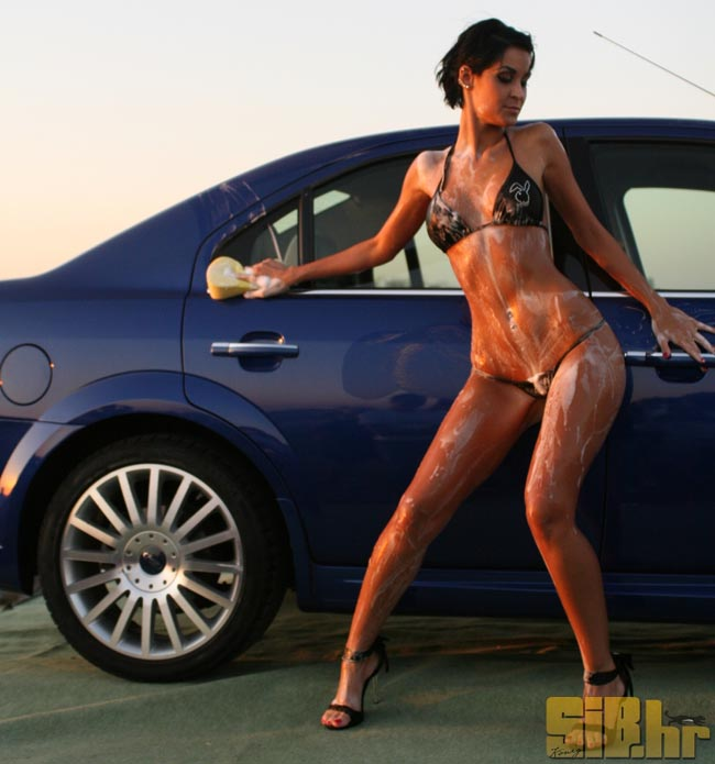 Sexy Girls Washing a Car