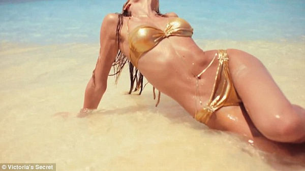 Sexy Candice Swanepoel in golden bikini