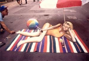 Girl on a beach mat.