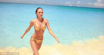 Sexy Candice Swanepoel in golden bikini